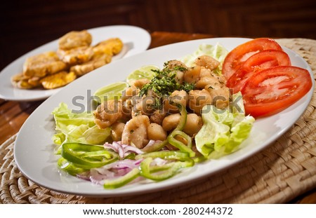 Delicious breaded calamari served with plantain chips, Manabi, Ecuador - stock photo