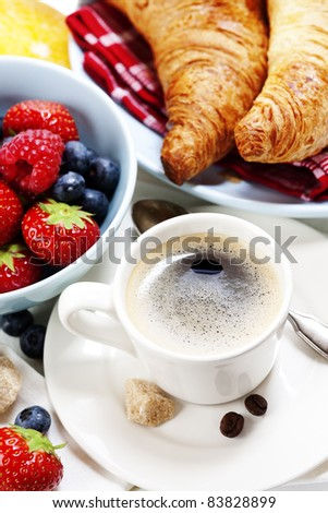 Delicious breakfast with coffee, fresh croissants and berries - stock photo