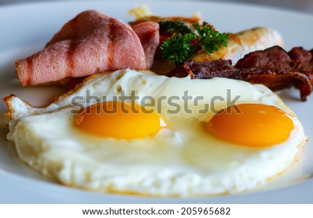 Delicious breakfast with fried eggs and bacon - stock photo