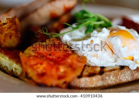Delicious breakfast with fried eggs, bacon and vegetables - stock photo