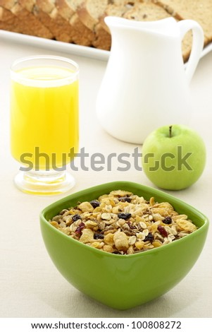 delicious breakfast with whole grain bread,fresh green apple and a healthy bowl of cereal. - stock photo