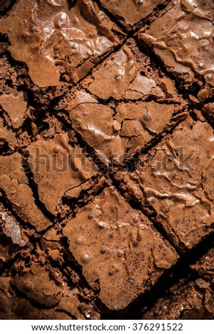 Delicious Brownies. Dark Chocolate Brownies, Fresh Baked from Oven, Square Sliced. Homemade Bakery, Pastry and Dessert. Rustic Still Life Style. Background and Textures, Close up, Top view. - stock photo