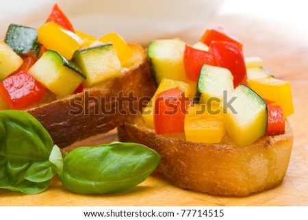 Delicious bruschetta from grilled zucchini and bell pepper on toasted bread - stock photo