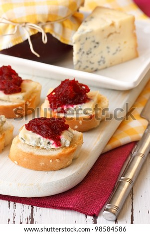 Delicious bruschetta with blue cheese and marmalade for breakfast.