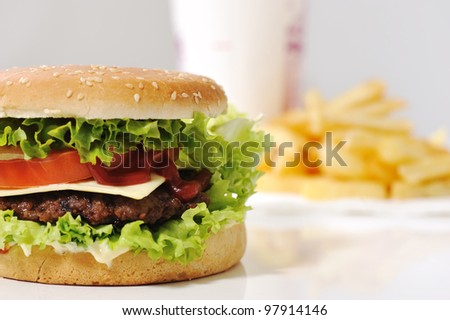 Delicious burger and fries and cola - stock photo