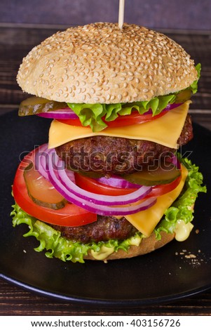 Delicious Burger With Beef, Tomato, Cheese, Lettuce and Onion - stock photo