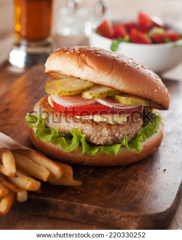 Delicious burger with vegetable and sauce,selective focus  - stock photo
