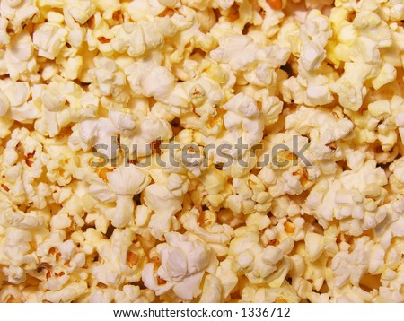 Delicious buttery popcorn background - stock photo