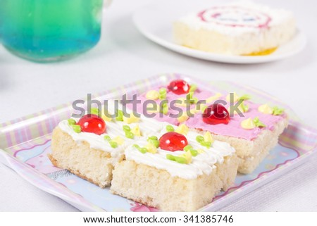 Delicious cake on plate on table on light background - stock photo