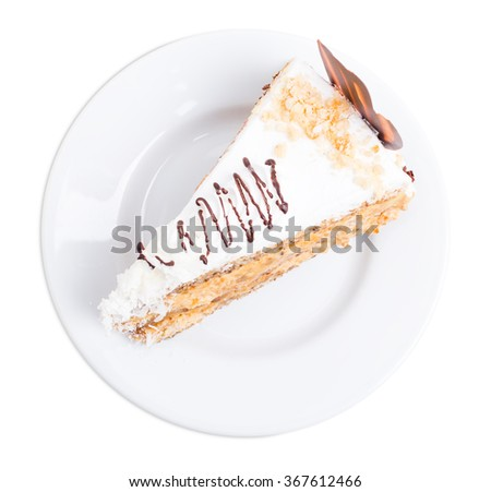 Delicious cake with chocolate curl and coconuts. Isolated on a white background. - stock photo