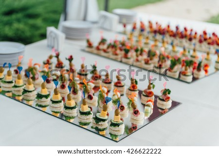 Delicious canapes as event dish. Strawberry cheese cucumber - stock photo