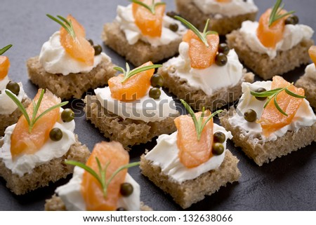 delicious catering finger food set with smoked salmon - stock photo