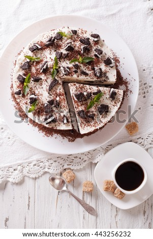 Delicious cheesecake with chocolate cookies closeup on a plate. Vertical view from above