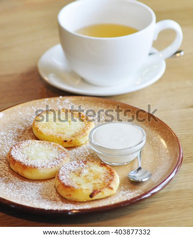 Delicious cheesecakes with sauce on the wooden kitchen   - stock photo