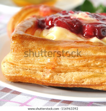 Delicious Cherry puff pastry with custard - stock photo