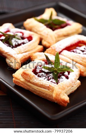 Delicious Cherry puff pastry with powdered sugar - stock photo