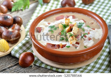 Delicious chestnut soup with celery and roasted bacon strips - stock ...