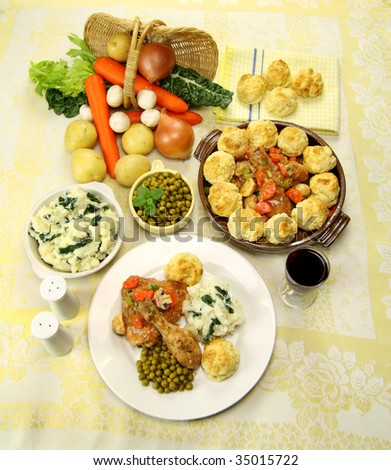 Delicious chicken and dumpling casserole with a selection of garden fresh vegetables. - stock photo