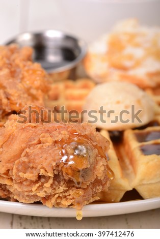 Delicious chicken and waffles with maple butter, honey and maple syrup. - stock photo