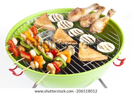 delicious chicken kebab on grill , isolated - stock photo