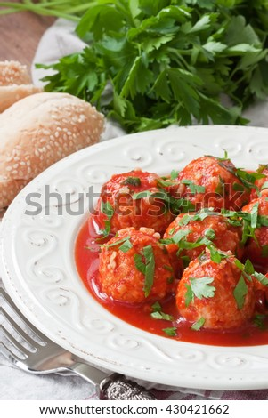 Delicious chicken or turkey meatballs with rice, vegetable in tomato sauce/Meatballs in tomato sauce  - stock photo