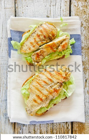 Delicious chicken sandwiches with bread butter cabbage - stock photo