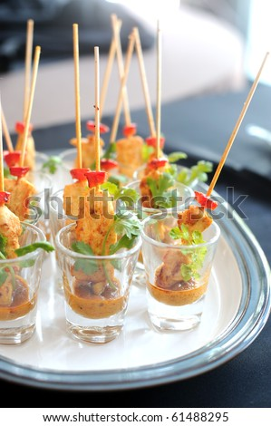 Delicious chicken satay skewers served in a glass