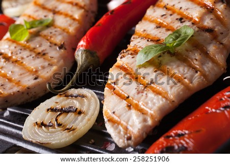 Delicious chicken with peppers, tomatoes and onions in a pan grill macro. horizontal - stock photo