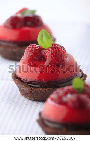 Delicious chocolate and raspberry cakes - stock photo
