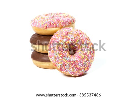 Delicious chocolate and strawberry donuts on white background - stock photo