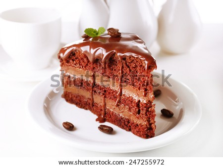 Delicious chocolate cake on plate on table on light background  sc 1 st  Shutterstock & Delicious Chocolate Cake On Plate On Stock Photo 247255972 ...