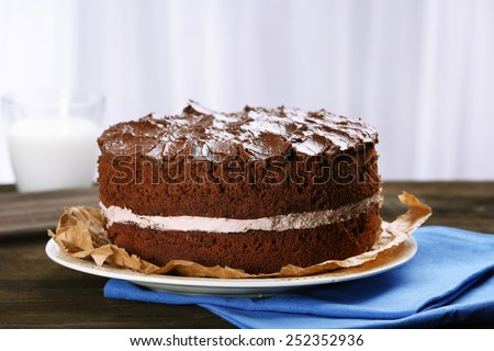 Delicious chocolate cake on table on light background - stock photo
