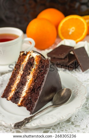 Delicious chocolate cake with cream and fruit - stock photo