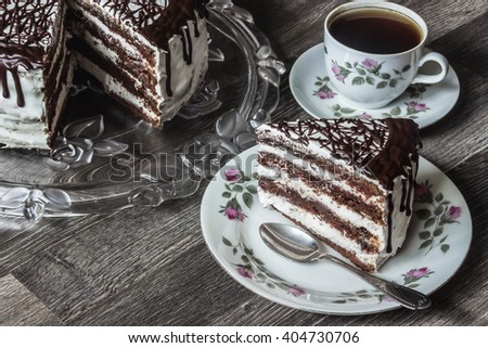 Delicious chocolate cake with creamy cream with coffee - stock photo