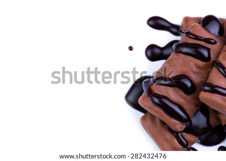 Delicious chocolate candies on a white background.