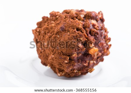 Delicious chocolate candy with nuts. Macro. Photo can be used as a whole background. - stock photo