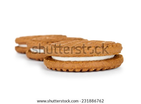 Delicious chocolate cookies with cream on isolated background - stock photo