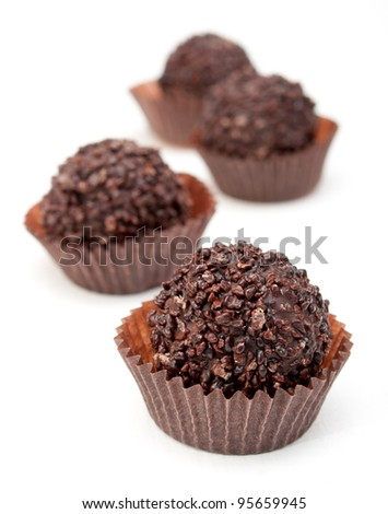 Delicious Chocolate Filled Pralines on White Background