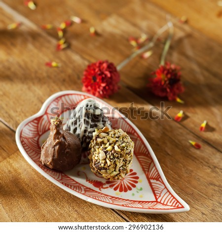 delicious chocolate hand made pralines- sweet food - stock photo