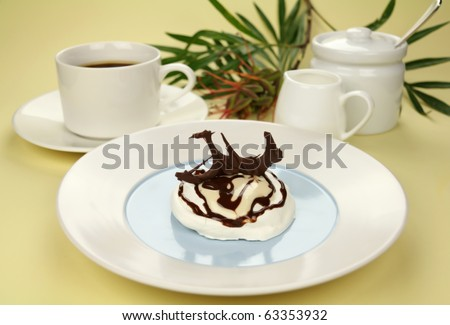 Delicious chocolate meringue with coffee and milk ready to serve. - stock photo
