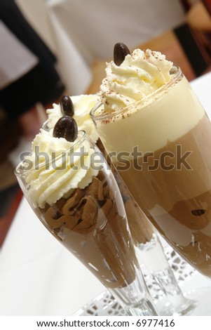 Delicious chocolate mousse dessert with three flavors - stock photo