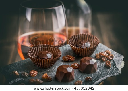 Delicious chocolate pralines on black background