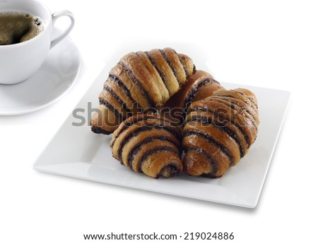Delicious chocolate rugelach with hot coffee - stock photo