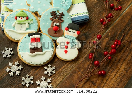Delicious Christmas cookies in blue tone on a wooden table