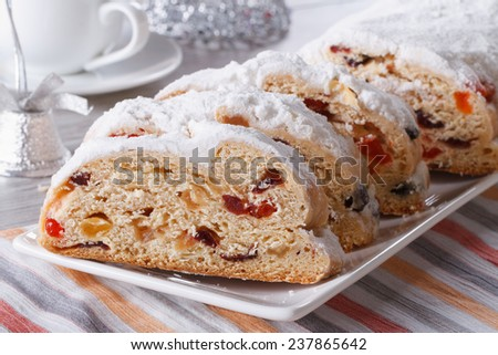 Delicious Christmas fruit bread Stollen closeup on a plate. horizontal  - stock photo