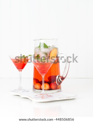 Delicious cocktail made with fresh cherries and peaches. - stock photo