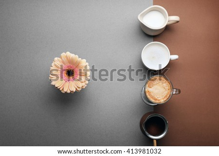 Delicious coffee and milk on table, top view