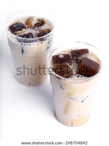 Delicious coffee with ice cubes - stock photo