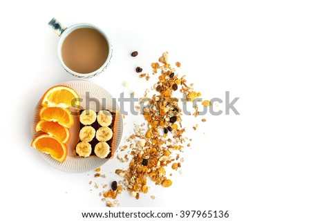 delicious coffee with oranges and banana on bread with chocolate and granola on white background, delicious breakfast concept - stock photo
