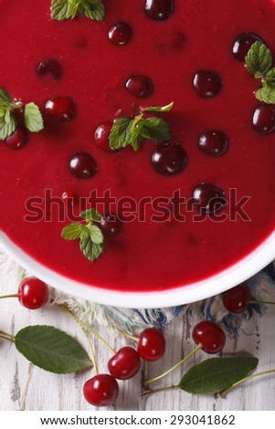 delicious cold cherry soup in a bowl on a table macro. vertical top view  - stock photo